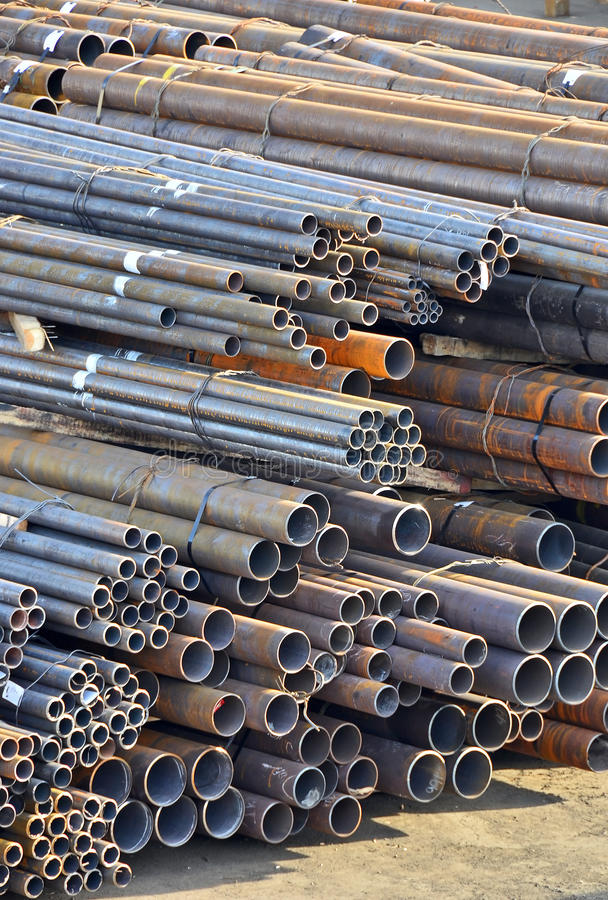 Stacked steel pipe. Stacked rusty steel pipe ready for shipment royalty free stock images