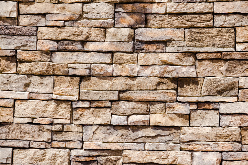 Stacked stone and mortar wall. Wall composed of stacked stone of different sizes royalty free stock photography