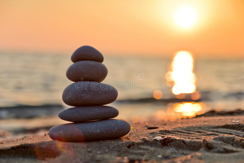 Stacked stones and sunset royalty free stock images