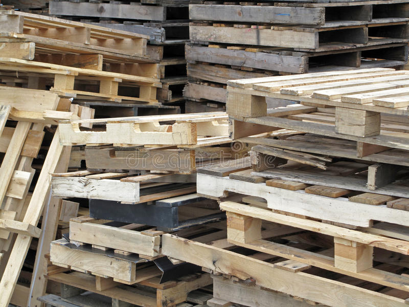 Stacked Used Pallets. A stack of industrial storage pallets stock photos