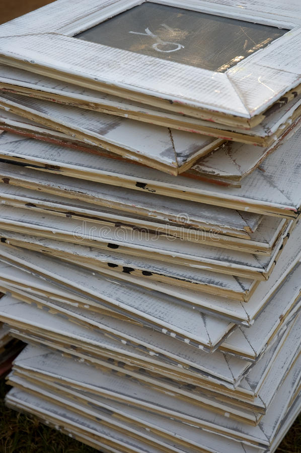 Stacked white grunge picture frames. A stack of white grunge wooden picture frames stock photography