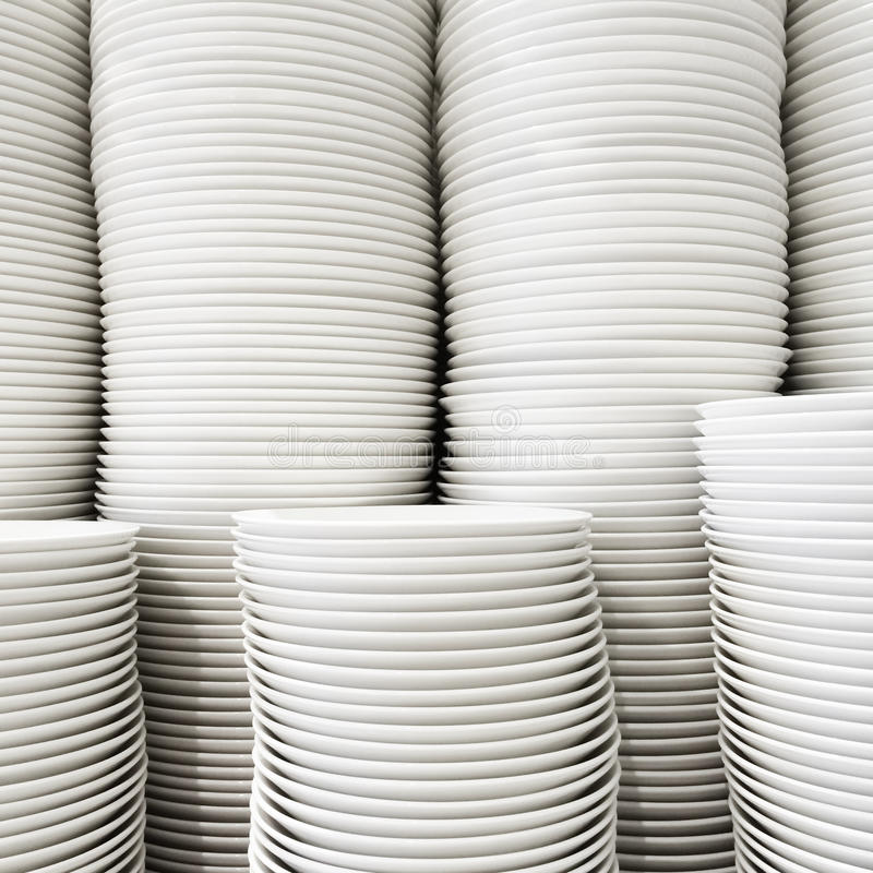 Stacked white plates stock photos