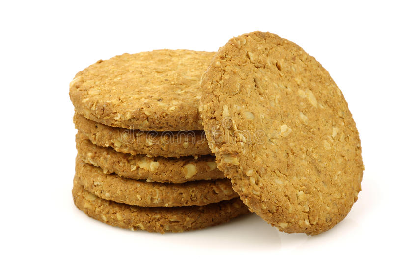 Stacked wholemeal cookies. On a white background stock photography