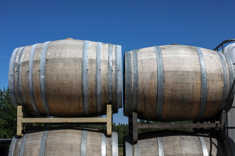 Stacked wine barrel with blue sky. Behind royalty free stock photography