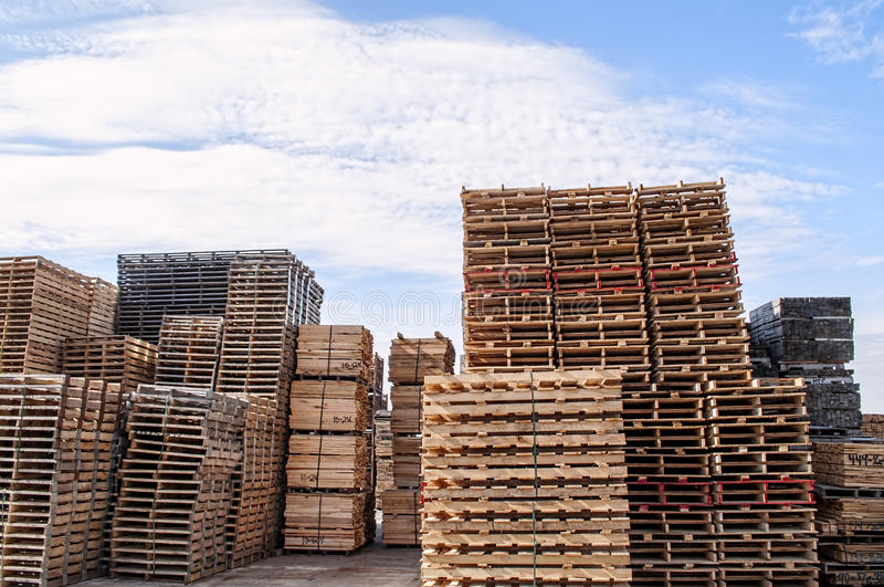 Stacked wood pallets and material. Stacks of pallets and sawn wood lumber for pallets at an Amish pallet factory royalty free stock photo