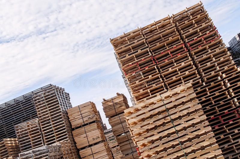 Download Stacked Wood Pallets And  Material Stock Photo - Image of forest, load: 46702028