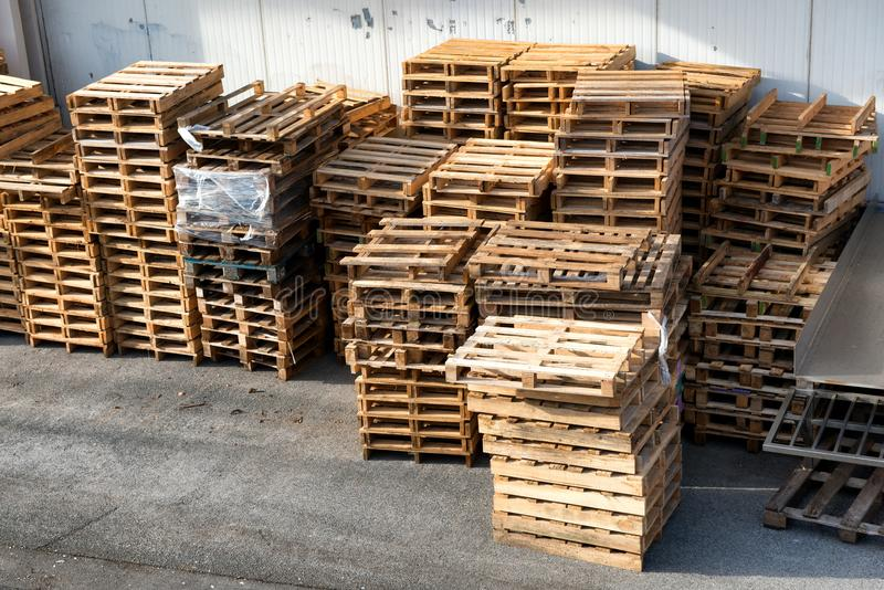 Stacked wooden pallets, for industry. A stacked wooden pallets, for industry royalty free stock photo
