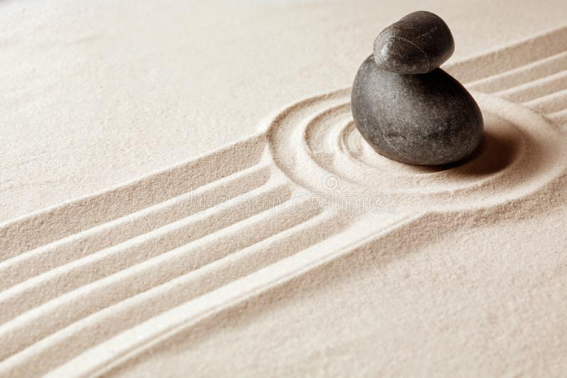 Stacked zen garden stones on sand with patterm stock image