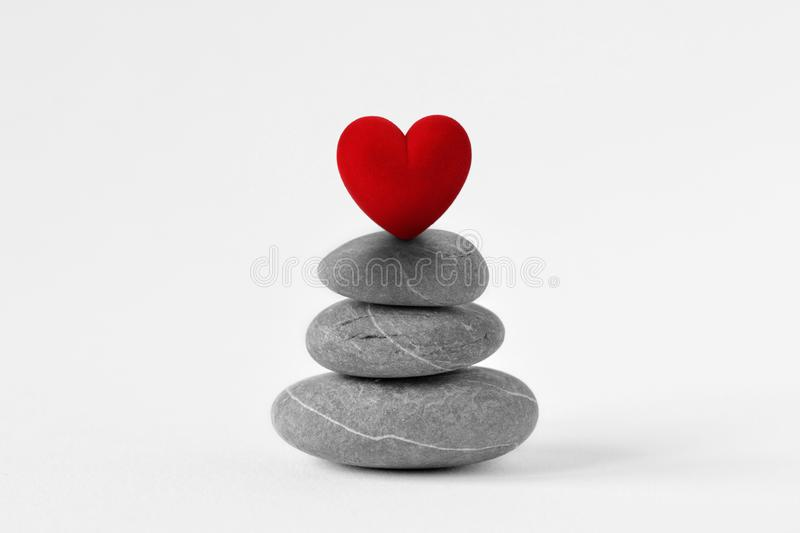 Stacked Zen stones with heart on white background - Concept of love and balance royalty free stock photography
