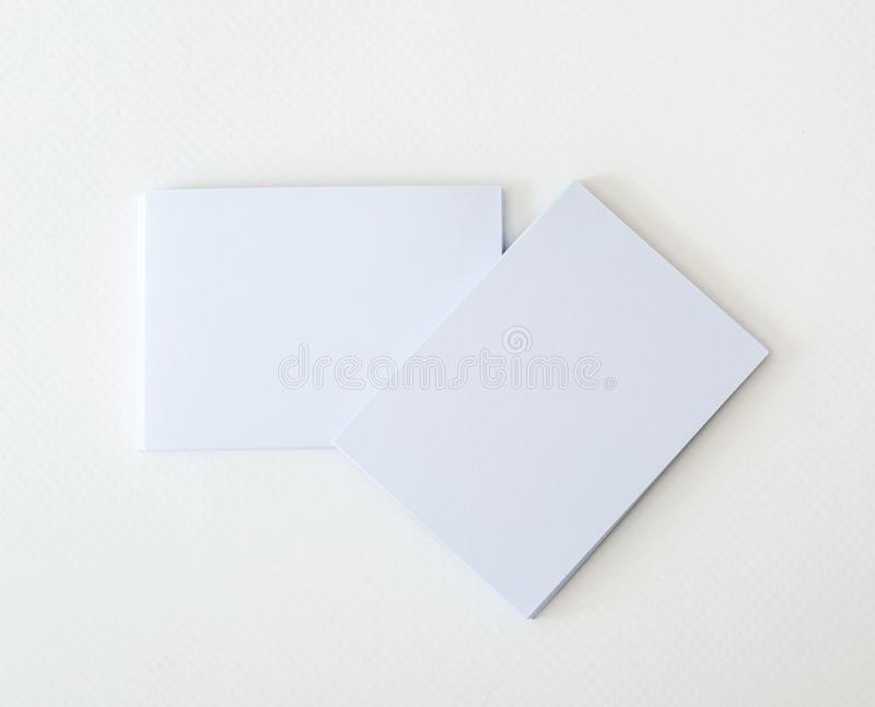 Stacking of mockup empty white business card on white paper background , a template for business branding identity design stock images