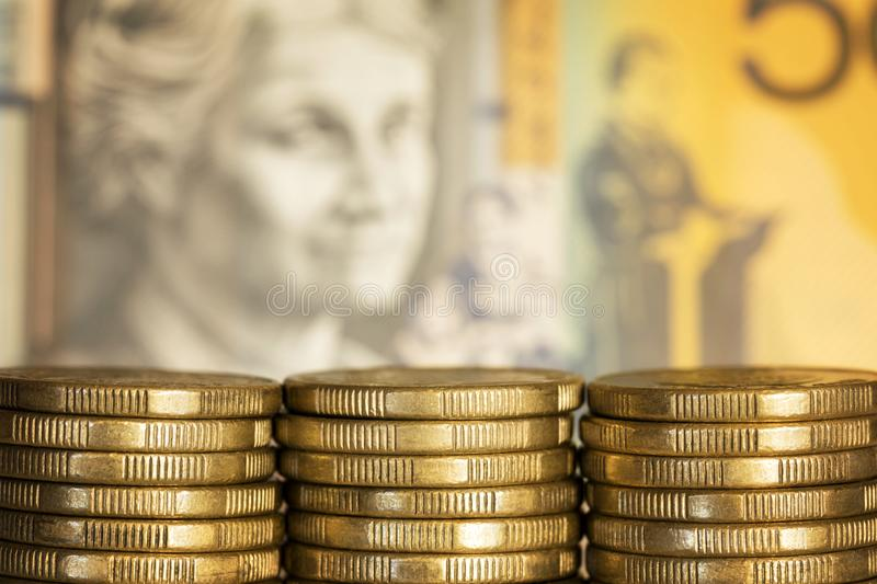 Australian Money Background. Stacks of Australian dollar coins over blurred money background royalty free stock photography
