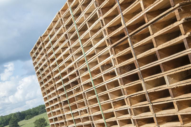 Wood pallets. Stacks of banded wooden pallets at a Missouri Amish saw mill and pallet manufactory company royalty free stock image