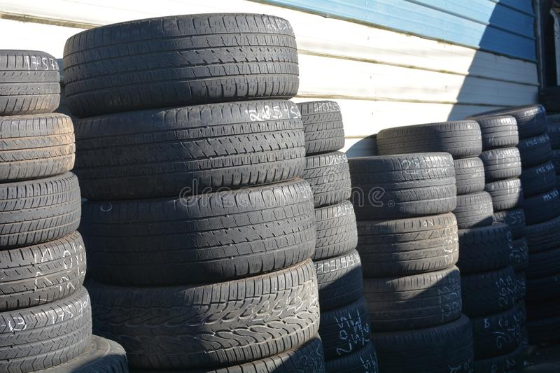 Stacks of black tires against a wall in Salem, Oregon. These are stacks of black tires against a wall at a tire store in Salem, Oregon stock images