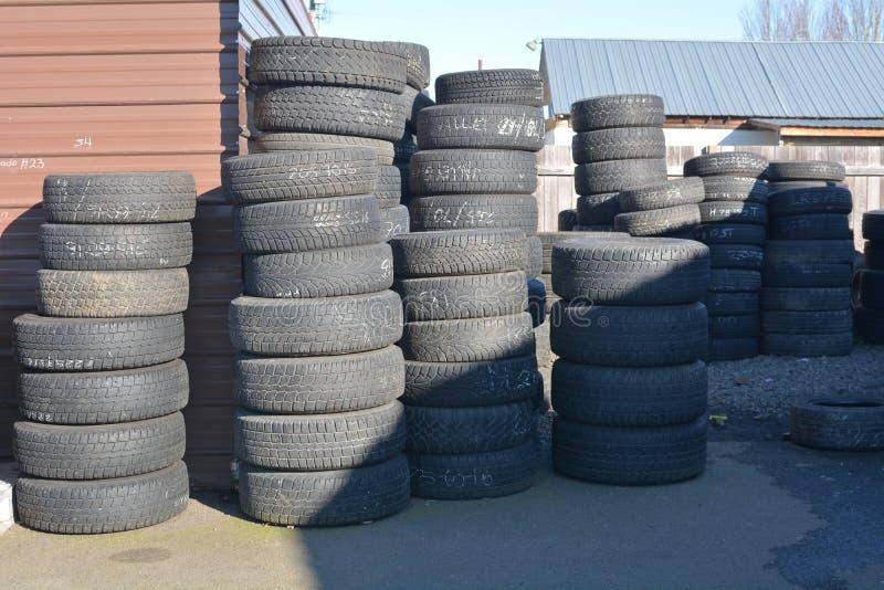 Stacks of black tires in Salem, Oregon. These are stacks of black tires in front of a tire store in Salem, Oregon stock photo