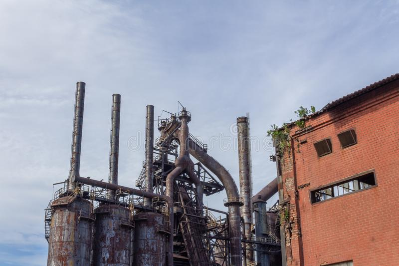 Stacks blast furnaces with rusting exterior, abandoned industrial landscape royalty free stock photos