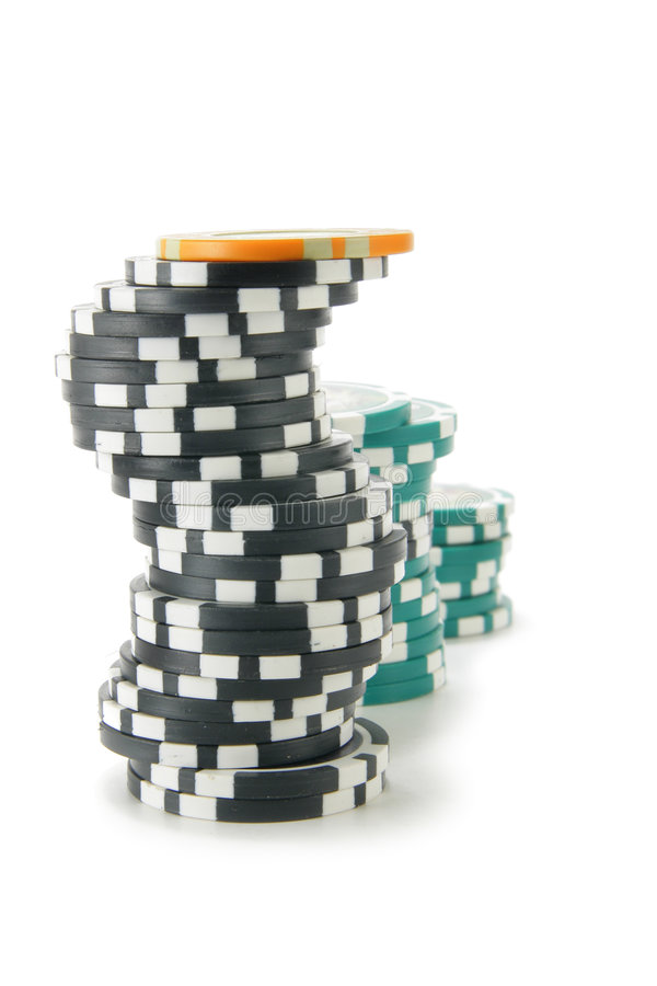 Stacks of casino chips. Isolated over a white background royalty free stock photography