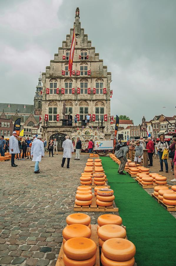 Stacks of cheeses for sale at the Market Square fair and gothic City Hall in Gouda. royalty free stock photos