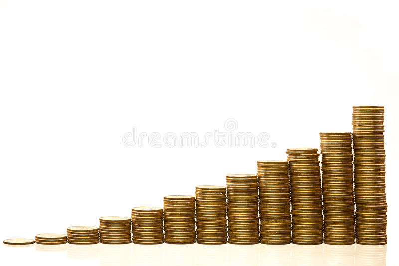 Stacks of coins. Stacks of golden coins isolated stock images