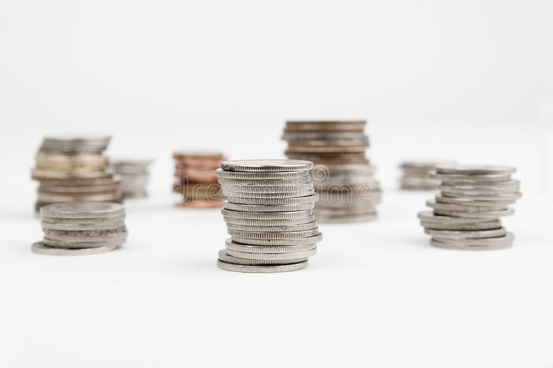 Stacks of coins isolated royalty free stock photos