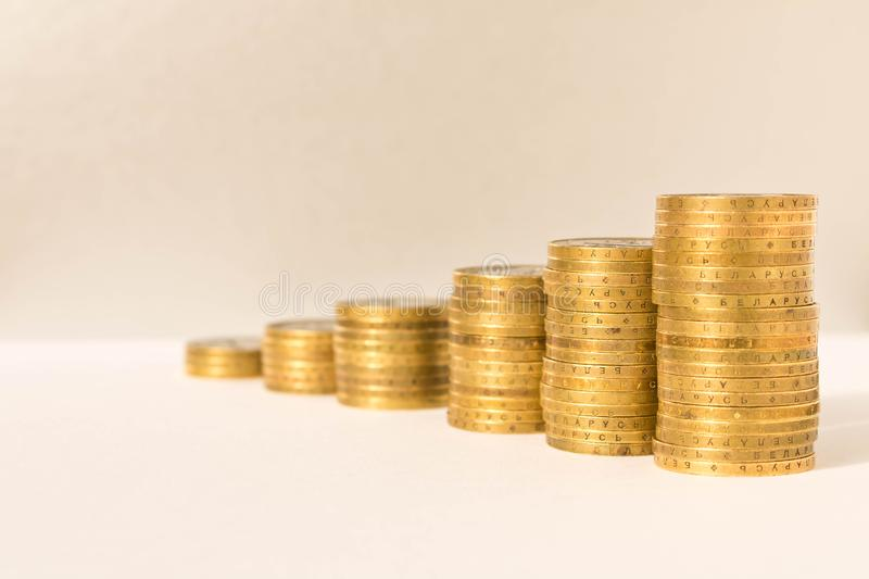 Stacks of coins on a light background. Business concept and growth of capital.  stock image