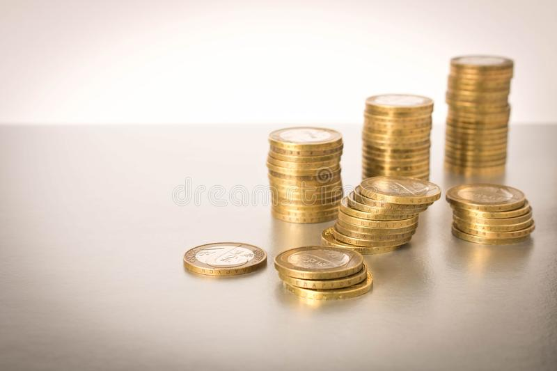 Stacks of coins on a light background. Business concept and growth of capital stock photo