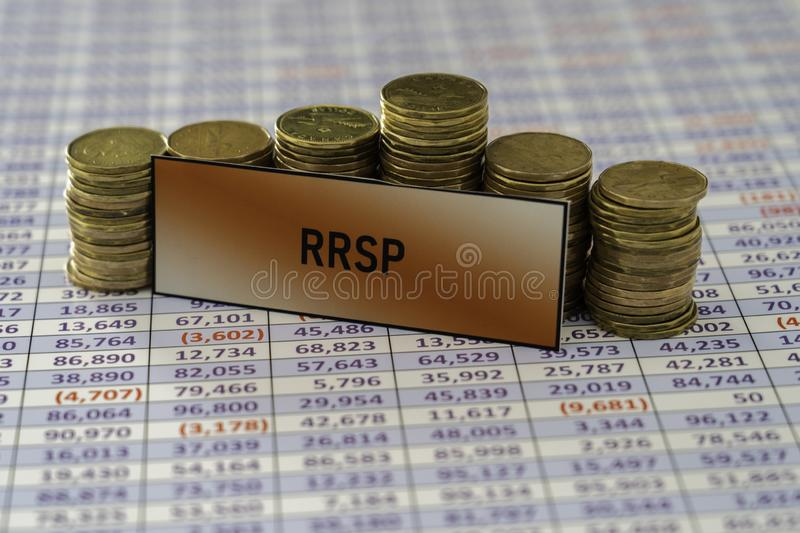 Stacks of coins on spreadsheet showing Growth in RRSP Savings stock image