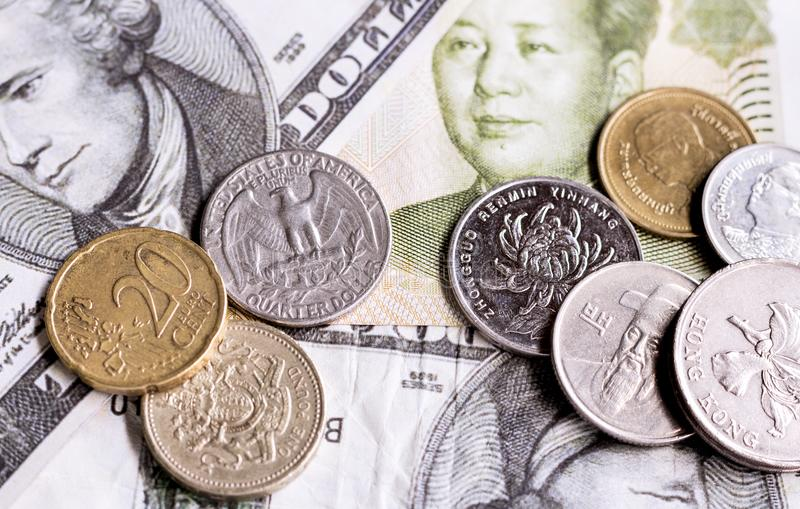 Stacks of coins with a variety of countries both in Asia and Eur stock photo