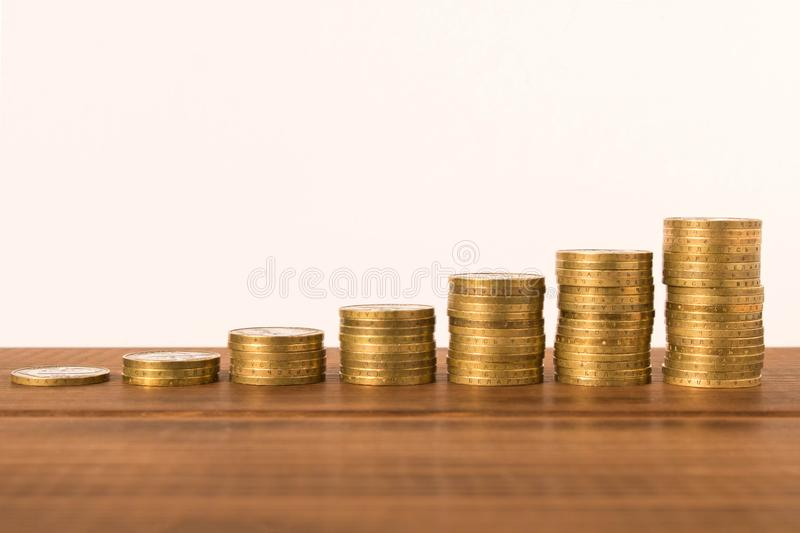 Stacks of coins on a wooden table. Business concept and growth of capital.  stock image