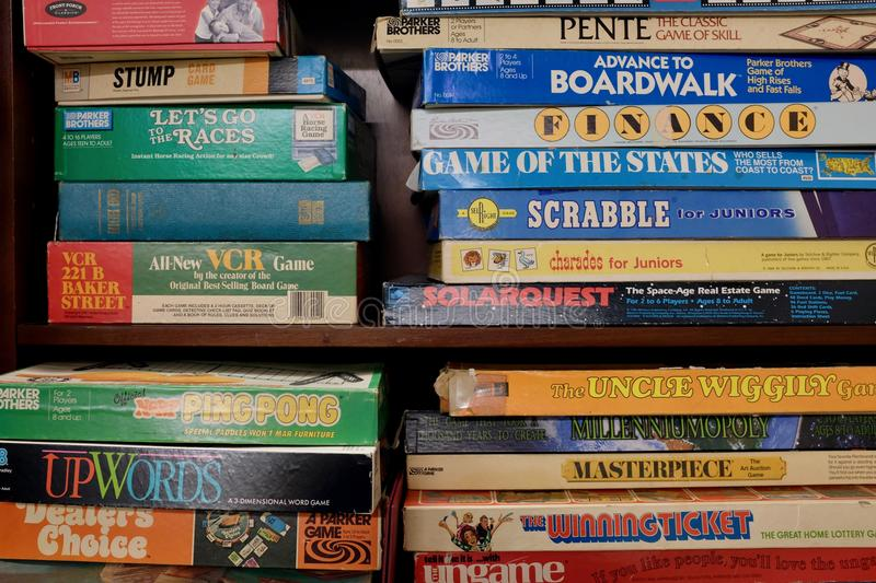 Stacks of Vintage Board Games. Stacks with collection of classic vintage antique board games, flea market treasure of retro games royalty free stock photo