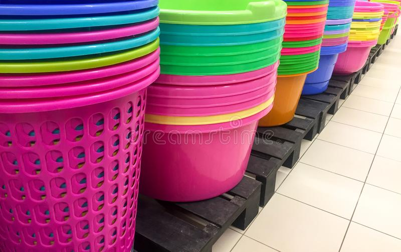 Colorful plastic buckets. Stacks of colorful laundry buckets on display for sale at department store royalty free stock photography
