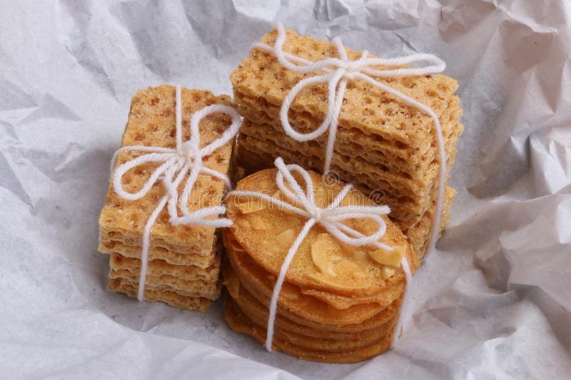 Stacks of Cookies. Stacks of Sugar Wafers and Almond Tuiles, just been unwrapped stock photography