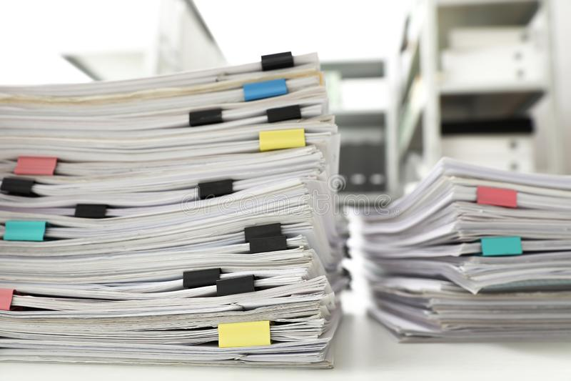 Stacks of documents with paper clips on office desk. Closeup royalty free stock image