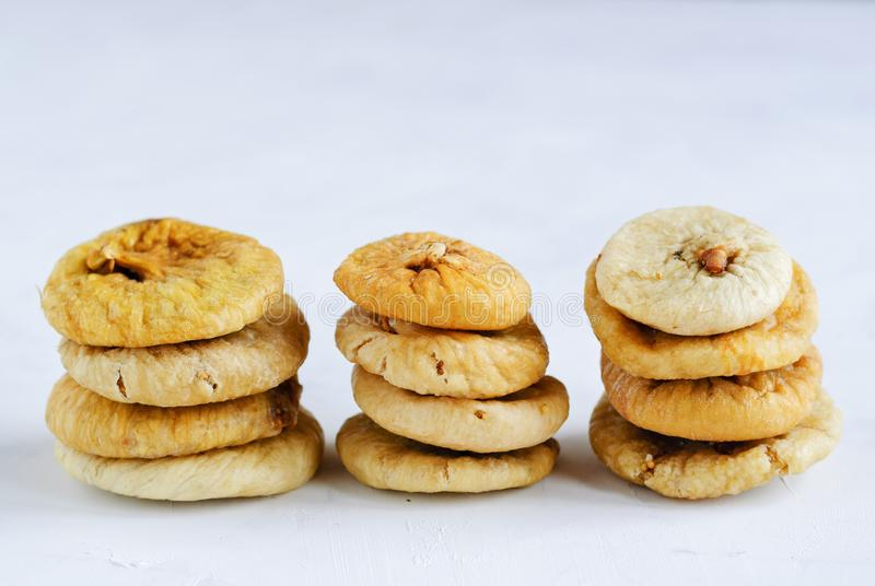 Stacks of dried figs on white backdrop royalty free stock photo