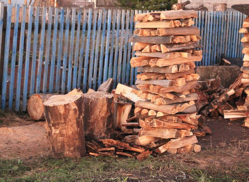 Stacks of firewood, pile of firewood on the grass royalty free stock images