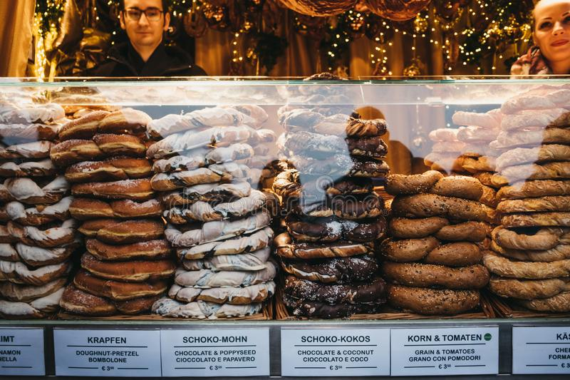Stacks of freshly made pretzels on sale at Christmas and New Year`s Market at Schonbrunn Palace, Vienna, Austria. stock photo