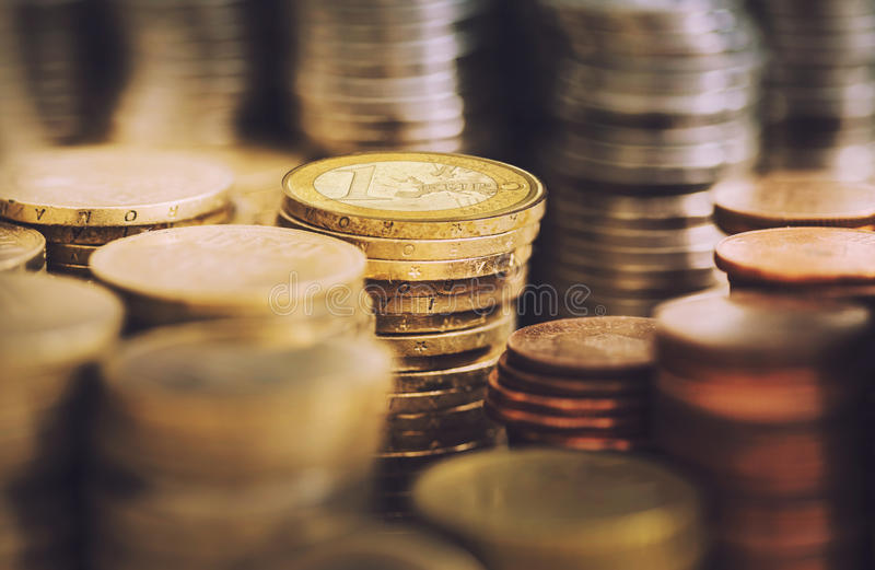 Stacks of golden euro coins royalty free stock images