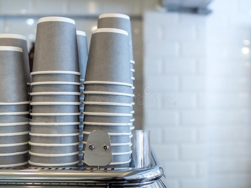 Stacks of grey paper cups and coffee cups stock images
