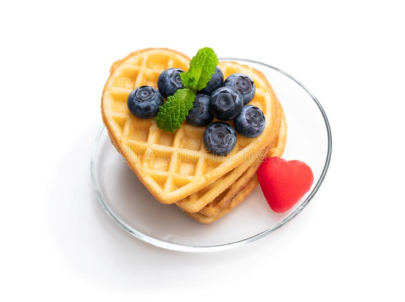 Stacks of heart shaped waffles with fresh blueberry isolated on white royalty free stock photos