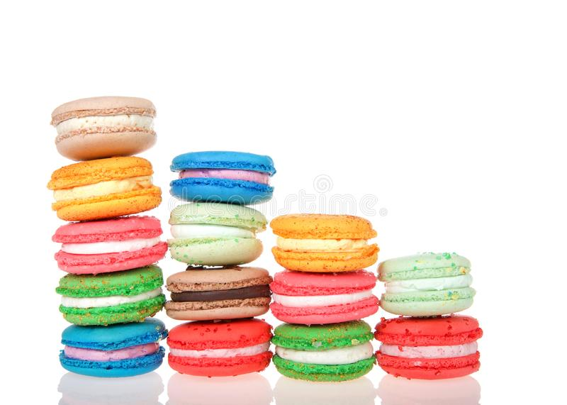 Stacks of macaron cookies isolated on reflective surface stock photos