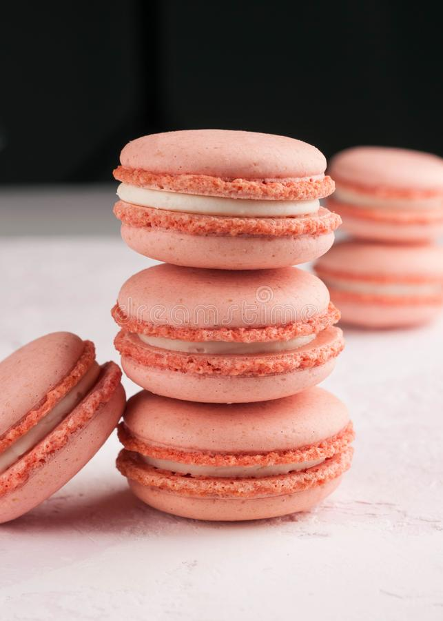 Stacks with macarons dessert on white and black royalty free stock photos