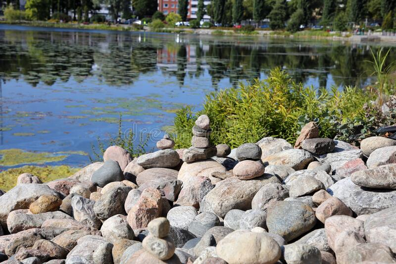 Relaxing, Zen Like View Including Stacks of Natural Rocks and a Lake during a Sunny Day stock images