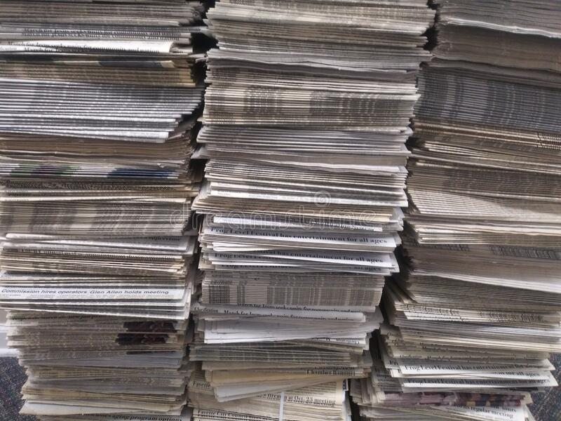 Stacks of newspapers stock images