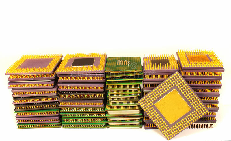Stacks of old CPU chips and obsolete computer processors royalty free stock photography