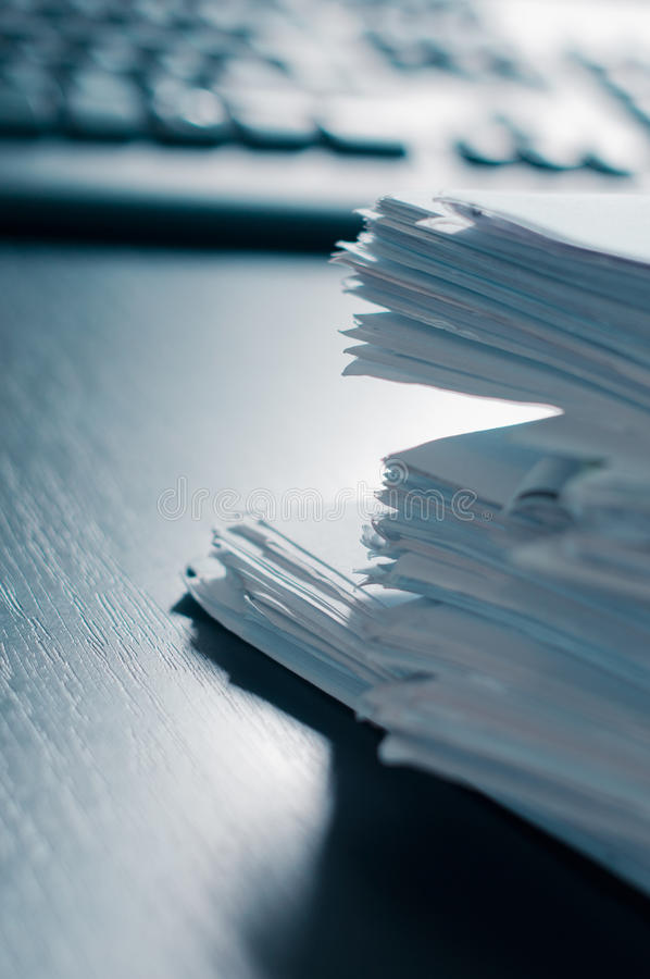 Stacks of paper on the office table stock photos