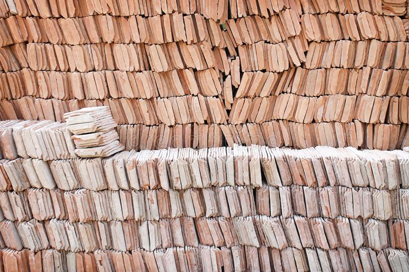 Stacks patterns of clay roof tiles for texture or background. Close up Stacks patterns of clay roof tiles for texture or background royalty free stock photography