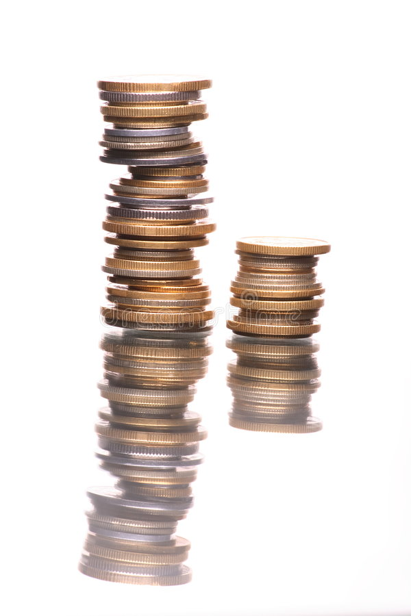 Stacks Of Reflecting Coins Stock Photos