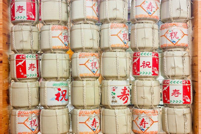 Stacks Of Sake Japanese Barrels Background With Kanji Letter Mean 'Celebration', 'Logivity', 'One Filtrate' stock image