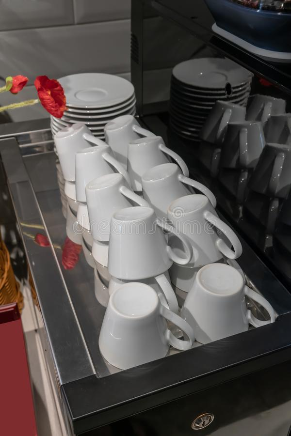 Stacks of upside down coffee cups prepared on machine. Stacks of upside down coffee cups prepared on espresso machine royalty free stock photos
