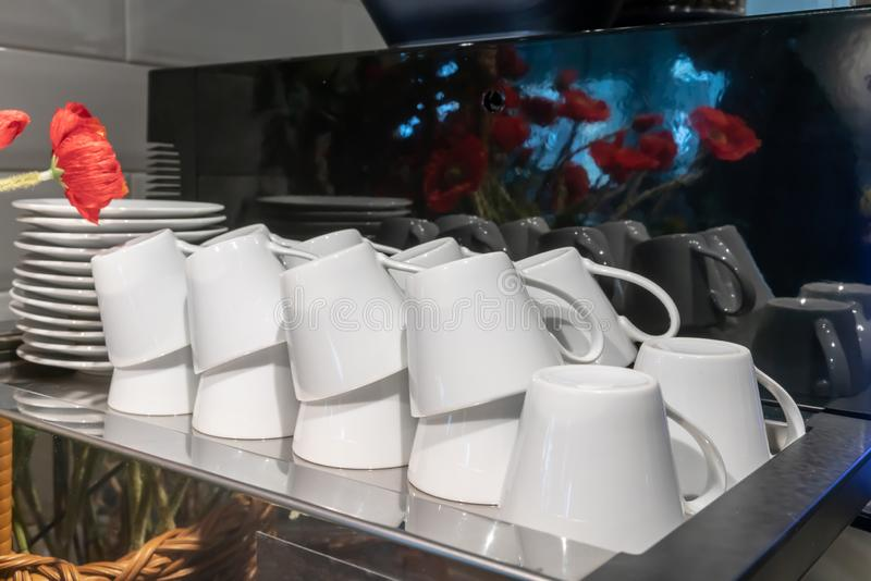 Stacks of upside down coffee cups prepared on machine. Stacks of upside down coffee cups prepared on espresso machine stock image