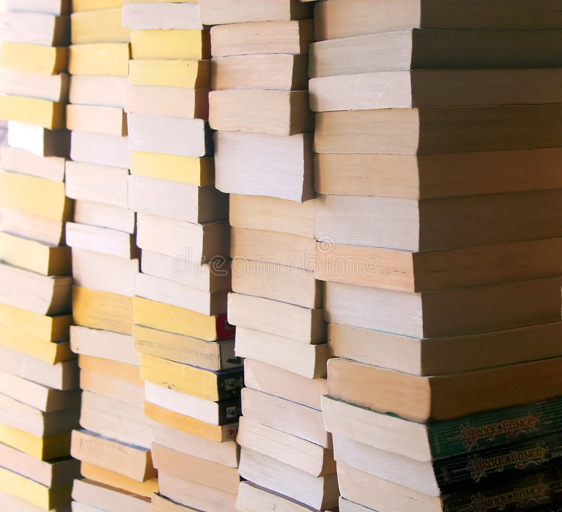 Stacks of Used Books. Stacks of used paper-back books of various ages royalty free stock photos